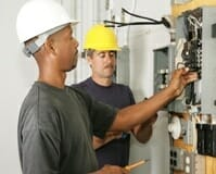 Electrician servicing a electrical panel